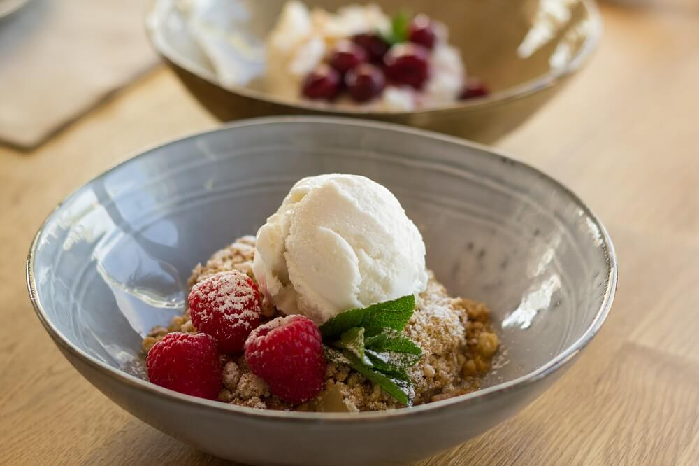 Strudel spiced apple crumble served with vanilla ice cream